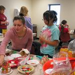 Children decorating gingerbread houses.